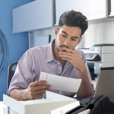 Man Using Business Remote Deposit
